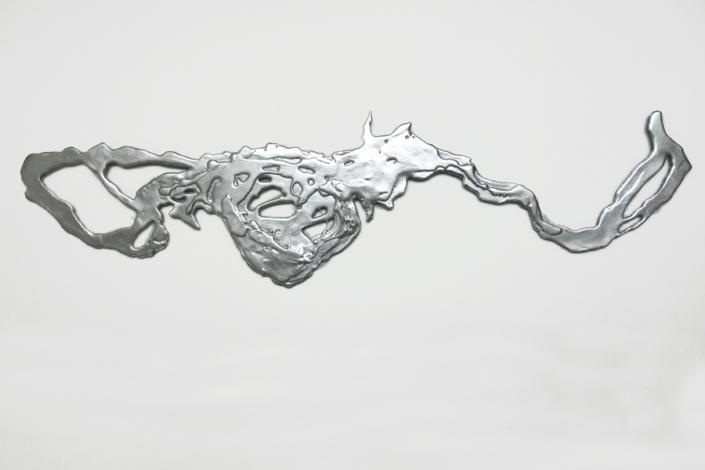 Marion Kieft - Yacireta, 2019 - epoxy resin, leaf silver - 2 x 25 x 110 cm
